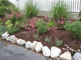 adding large rocks to edge the garden area, landscape, outdoor living