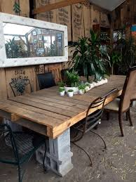 Decking Using Pallets Big Shipping Pallet And Concrete Block Outdoor Table Repurpose