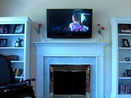 spectacular how to hide tv wires over stone fireplace plasma tv mounted over fireplace
