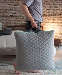 The oversized Puffa floor pillows can be moved around thanks to a stylish  handle.