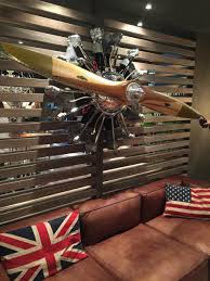 arteinmotion is a furniture brand themed on aviation each of its designs is associated with an original part of aircraft for example a lamp is made with aviation themed furniture