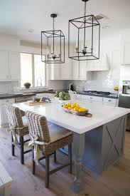 to add light and character to the kitchen space designers hung two unique metal pendant