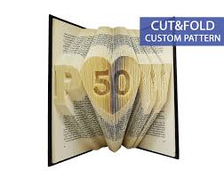 custom folded book art pattern cut fold initials with a heart and number