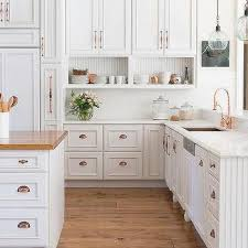 cabinet cup pulls.  Cup White Kitchen Cabinets With Copper Cup Pulls And Sink On Cabinet N