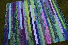 How to Make a Jelly Roll Quilt: 49 Easy Patterns | Guide Patterns & Jelly Roll Race Quilt Instructions Adamdwight.com