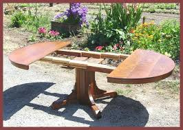 pedestal oak table table top shown open opens enough for the two original leaves and the pedestal oak table oak pedestal table with leaf