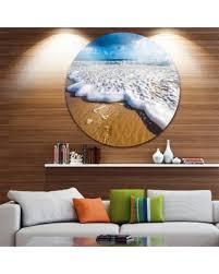 designart foaming ocean waves on sand seascape disc metal wall art 23 x on extra large ocean wall art with surprise 10 off designart foaming ocean waves on sand seascape