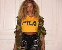 fila yellow top. check out her fila look below; all images via beyonce.com. yellow top