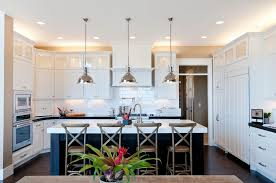 pendant lighting over kitchen sink cottage kitchen with quartz counters by candlelight homes zillow