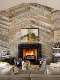 reclaimed wood accent wall in chevron design fireplace and stone