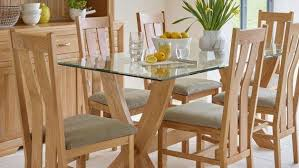 Glass top dining tables Urban Ladder Glass Dining Tables Oak Furniture Land Oak Glass Dining Tables Glass Tables Oak Furnitureland
