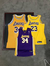 My new LeBron Jersey next to an authentic Magic jersey, and ...