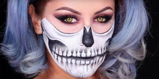 this easy half skull makeup look will make you look like an actual skeleton at your next party