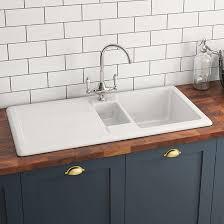 white kitchen sink. RAK 1000 Gourmet 1.5 Bowl White Ceramic Kitchen Sink With Reversible Drainer - 1010 X 510mm Rollover Image I