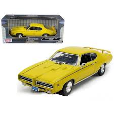 1969 Pontiac GTO Judge Yellow <b>1/18 Diecast Model</b> Car By Motormax