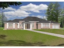sprawling stucco ranch with contemporary florida design