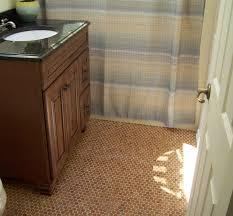 cork floor in bathroom install with single bathroom vanity units and black granite countertop and sink