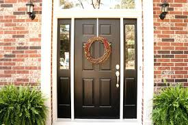 this matte black door pops framed in white on a red brick home front house pictures
