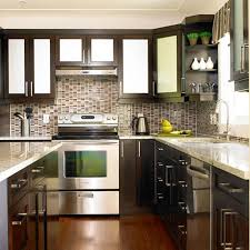 deluxe black polished ikea kitchen cabinets with marble top as well as fake wood floors in small space kitchen ideas