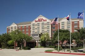 the building where the hotel is located a bathroom at hilton garden inn dallas allen