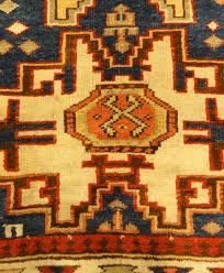 rare antique leshgi star rug featuring men standing on horses a piece of genuine antique