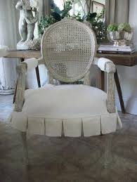 white pleated slipcover for seat of french chairs from full bloom cote