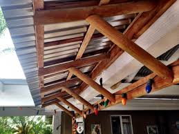 the corrugated metal but that wasn t the case i used 2 x 4 s for the facia 2 landscaping poles for the rafters and 1 x 2 s for the cross supports
