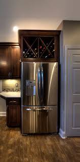 wouldn t a wine rack above a fridge always be a bit warm not ideal for wine storage