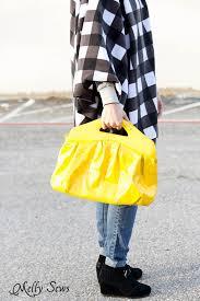 buffalo plaid poncho and yellow purse love sew an easy fleece poncho diy