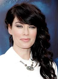 lena headey s long curly romantic hairstyle with bangs