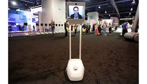 future home office gadgets. an offsite demonstrator interacts with attendees through a beampro telepresence robot at the beam future home office gadgets f