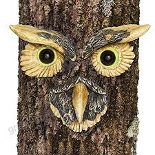 bits and pieces owl face tree hugger garden ker yard art outdoor tree