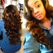 curly highlighted hairstyle for black women with long hair