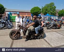 couple riding their rat bike style custom harley davidson chopper