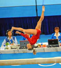 Image Simone Biles Usa Gymnast Shawn Johnson Does Somersault On The Balance Beam At The Beijing Olympics Gold Medal Impressions Gold Medal Impressions Usa Gymnast Shawn Johnson Does Somersault On The Balance Beam At