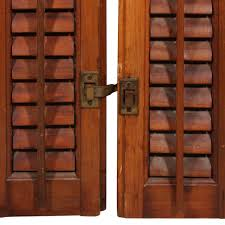 an outstanding pair of antique wooden shutters that date from the early 1900 s salvaged from a house in nashville tn these interior shutters are stained