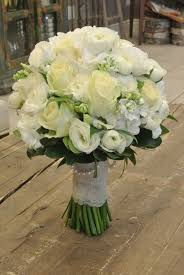 bridal bouquet with roses ranunculus lisianthus stocks and hydrangea designed by forget