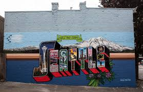 arriving at seattle marked our first time crossing the country with the rv we rolled around the city getting ourselves acquainted to the lush  on wall art seattle wa with seattle wa greetings tour us postcard mural artists traveling in rv