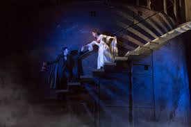 chris mann stars as the phantom and katie travis stars as christine daaé in the national tour of phantom of the opera matthew murphy