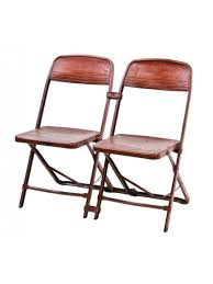 1940 s vintage interconnected hinged metal folding chairs with old red paint finish