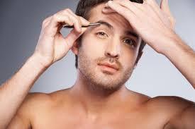 how to trim bushy eyebrows. man plucking his eyebrows how to trim bushy e