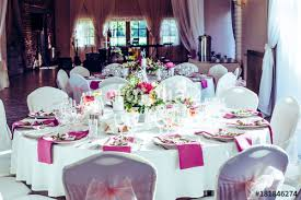 wedding round table decorations with beautiful flowers purple tissues lot of wine glases and