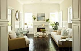 all white mid century design living room with black iron framed wall fireplace white marble