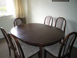 dark wood extending dining table dark wood extending dining table and 6 chairs in wigan