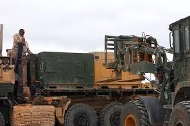 u s department of > photos > photo essays > essay view u s marines observe the loading of generators onto trucks on forward operating base delaram