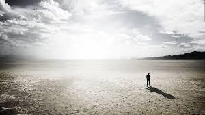 sad lonely man on wasteland