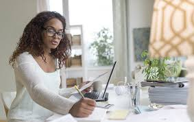 healthy home office design ideas. Woman Sitting At Computer In Home Office Healthy Design Ideas