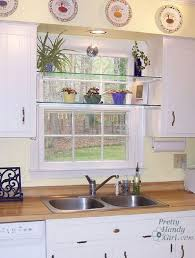 delightful diy glass shelves in front of kitchen window