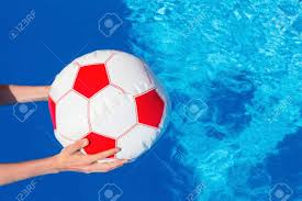 pool water with beach ball. Hands Of Boy Holding Beach Ball Above Swimming Pool Water Invitation To Play Stock Photo - With I