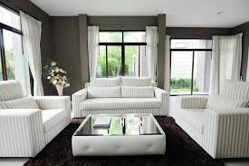 area mirror tables for living room. unique low profile square white tufted ottoman centers this living room with full mirrored table top area mirror tables for